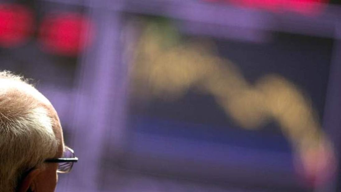 A trader watches the index at Madrid Stock Exchange