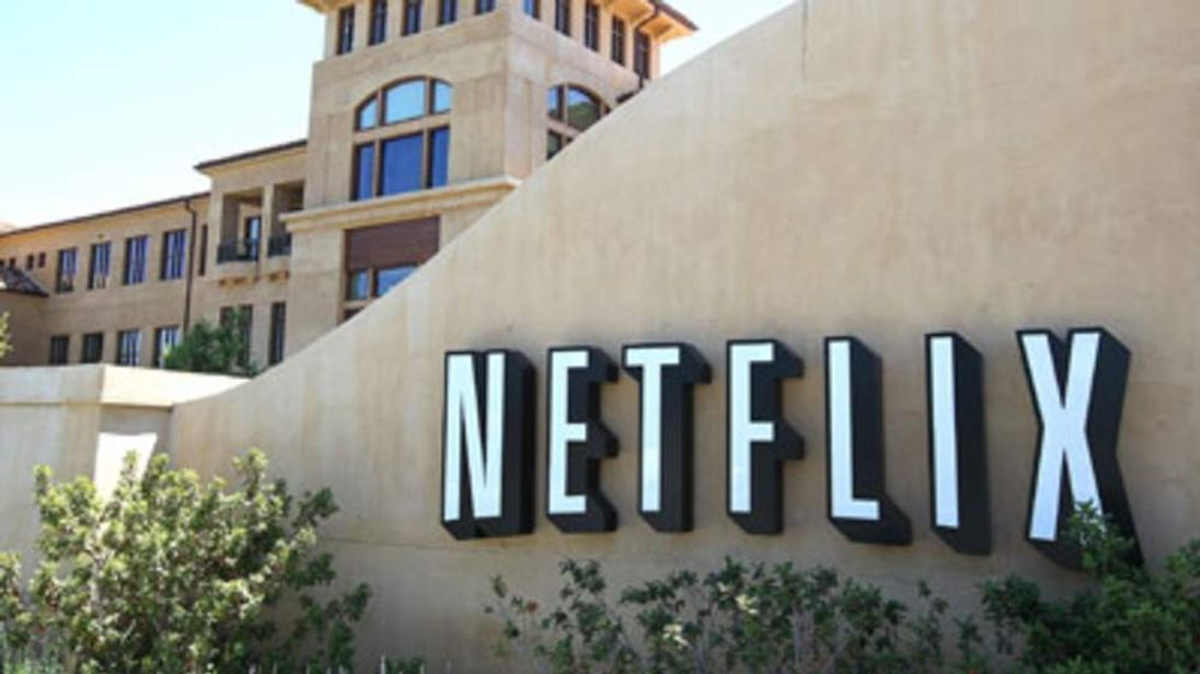 A sign is posted in front of the Netflix headquarters.