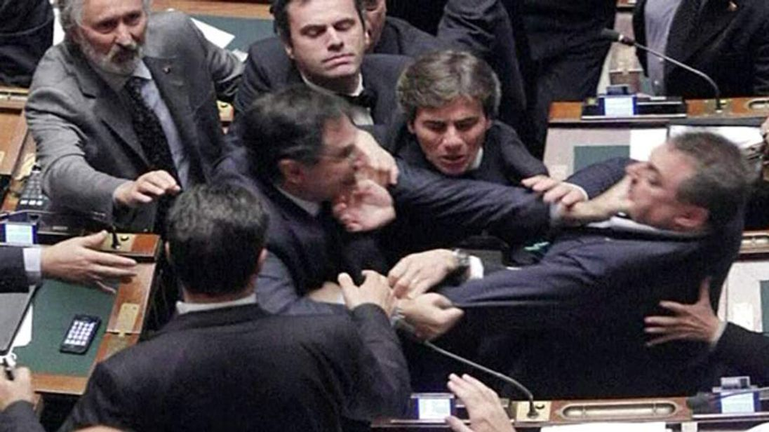 Claudio Barbaro (L) fights with Fabio Rainieri (R)