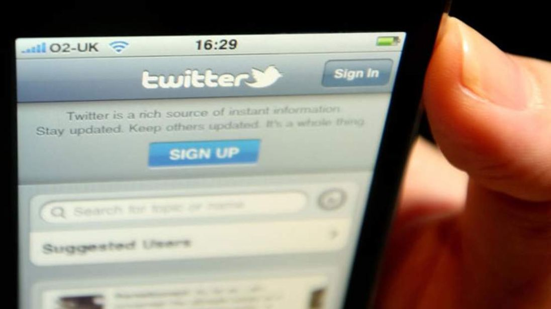 logo of social networking website Twitter, displayed on the screen of an iPhone smartphone as journalists and legal commentators no longer have to make an application for permission to Twitter