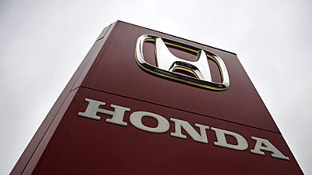 A Honda sign is seen outside a dealership In Ottershaw, southern England.