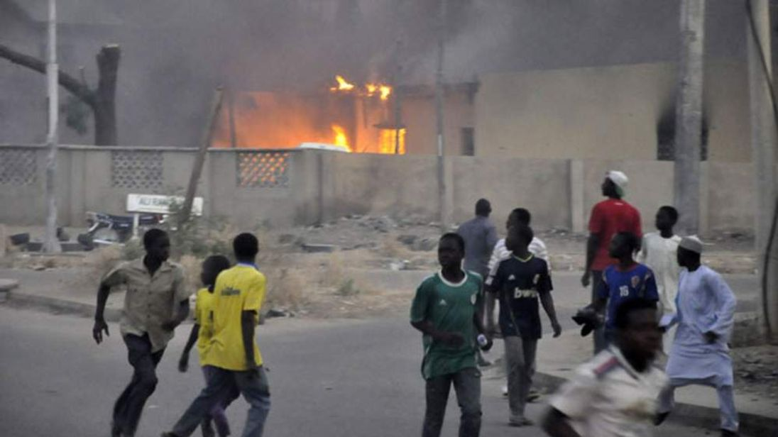 People run for safety after the bomb blasts in Kano, Nigeria, January 20 2012