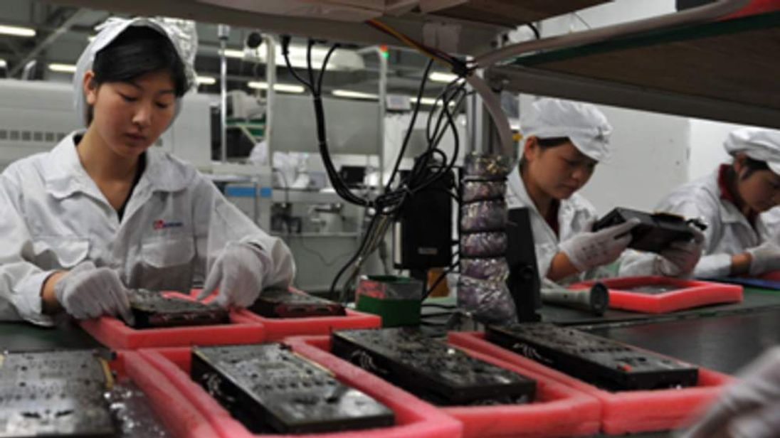 Workers At Apple Foxconn Factory