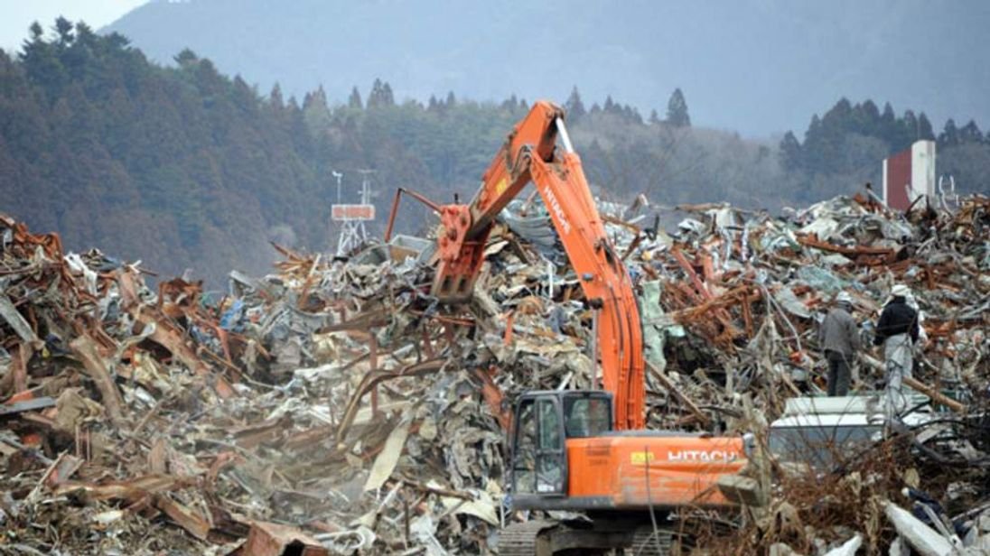 Heavy machinery tackles the tsunami devastation in Rikuzentakata, Japan, March 2012