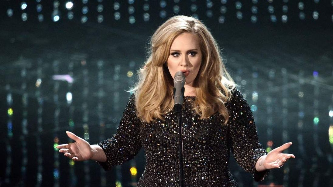 Singer Adele performs onstage during the Oscars