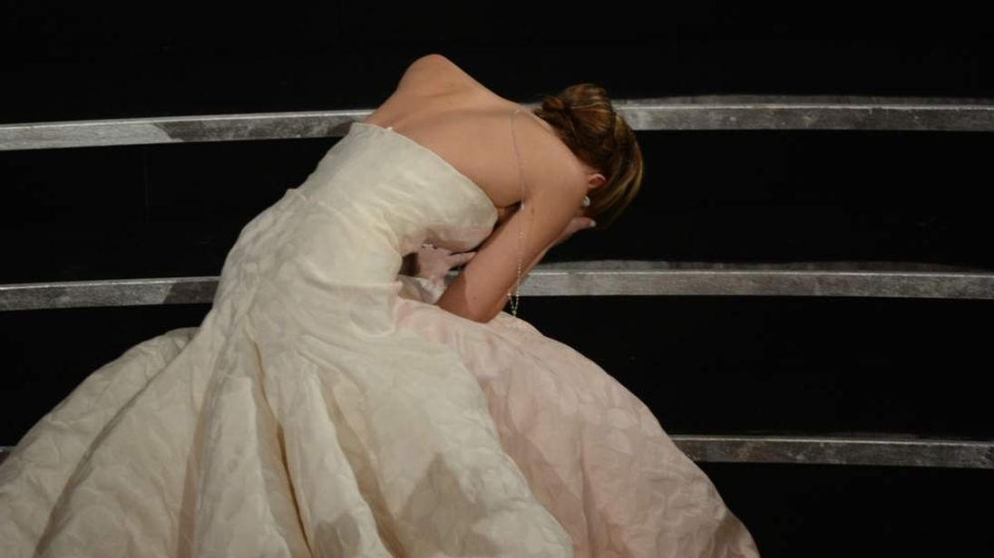 Best Actress winner Jennifer Lawrence falls onstage