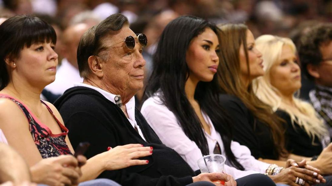 Sterling seated next to V Stiviano