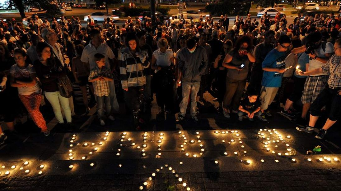 Citizens of Sarajevo light candles in front of the Bosnian government building in memory of Berina Hamidovic