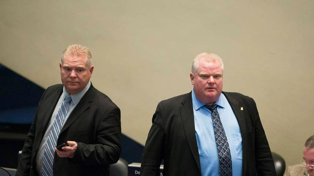 Toronto City Councillor Doug Ford (L) stands next to Mayor Rob Ford