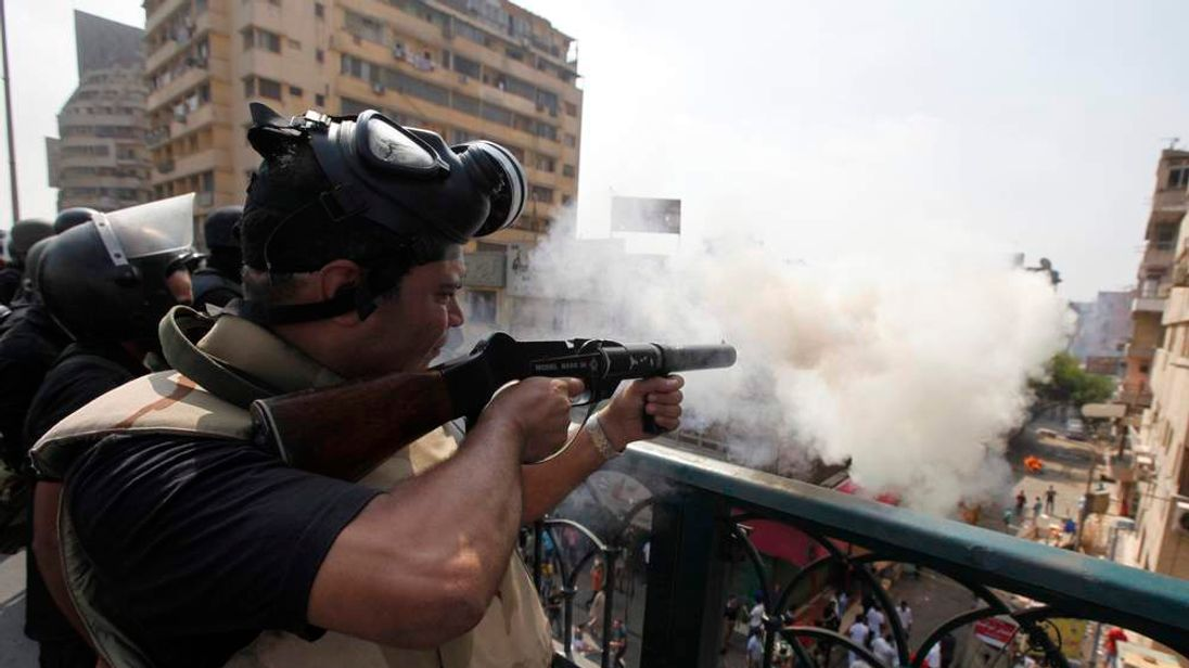 Riot police fire tear gas during clashes with members of the Muslim Brotherhood and supporters of deposed Egyptian President Mohamed Mursi, around Cairo University and Nahdet Misr Square, where they are camping in Giza