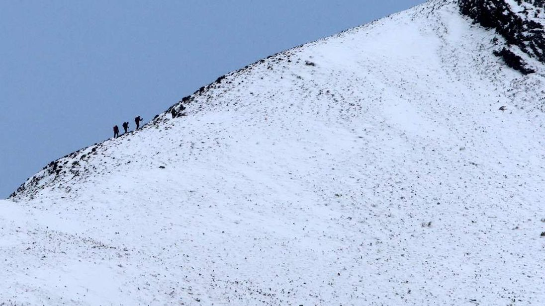 Climbers on mountain near Glencoe