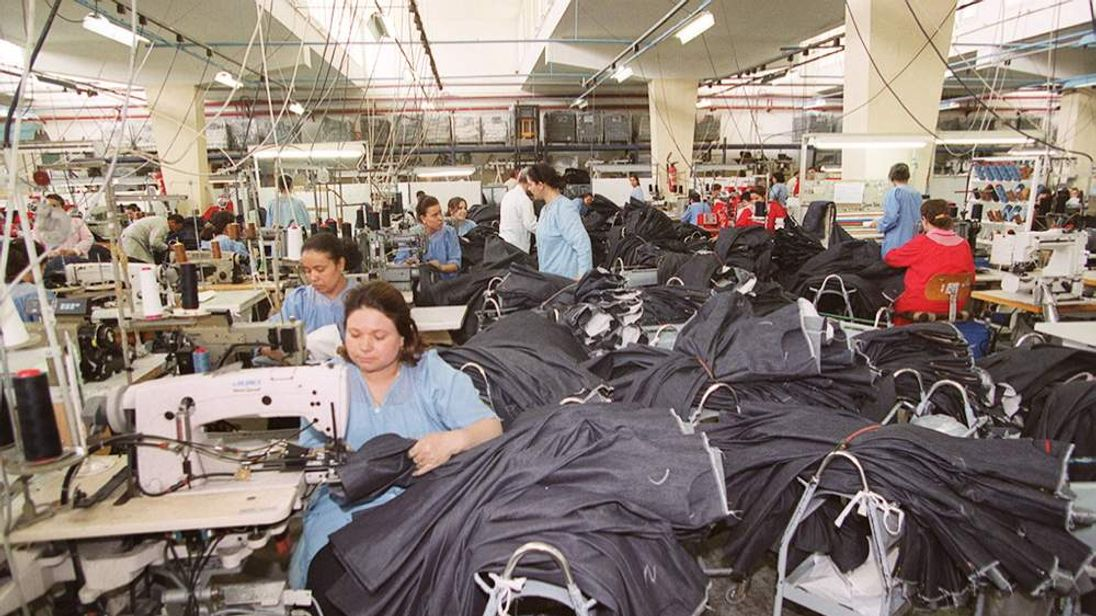 Workers assemble Lee Cooper jeans in a Lee Cooper factory located in Ras-Djebel, northeastern Tunisia
