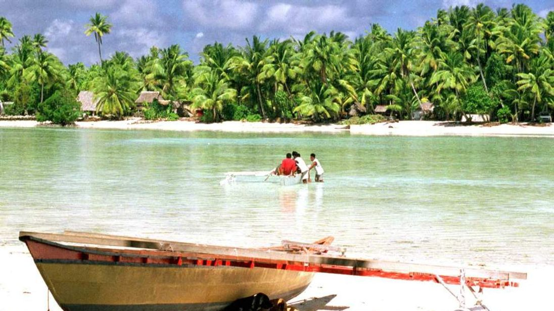 A traditional Micronesian canoe sits on the shore in Kiribati, in the middle of the Pacific Ocean