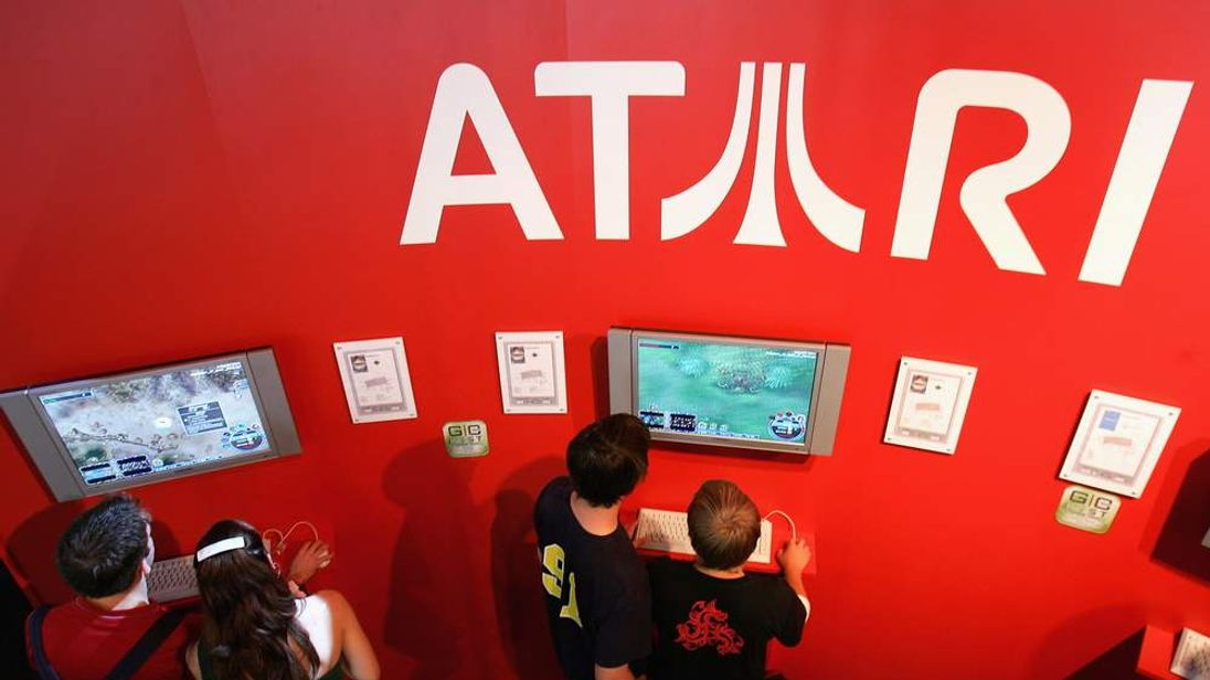 Visitors play Atari titles at a computer gaming convention in Leipzig