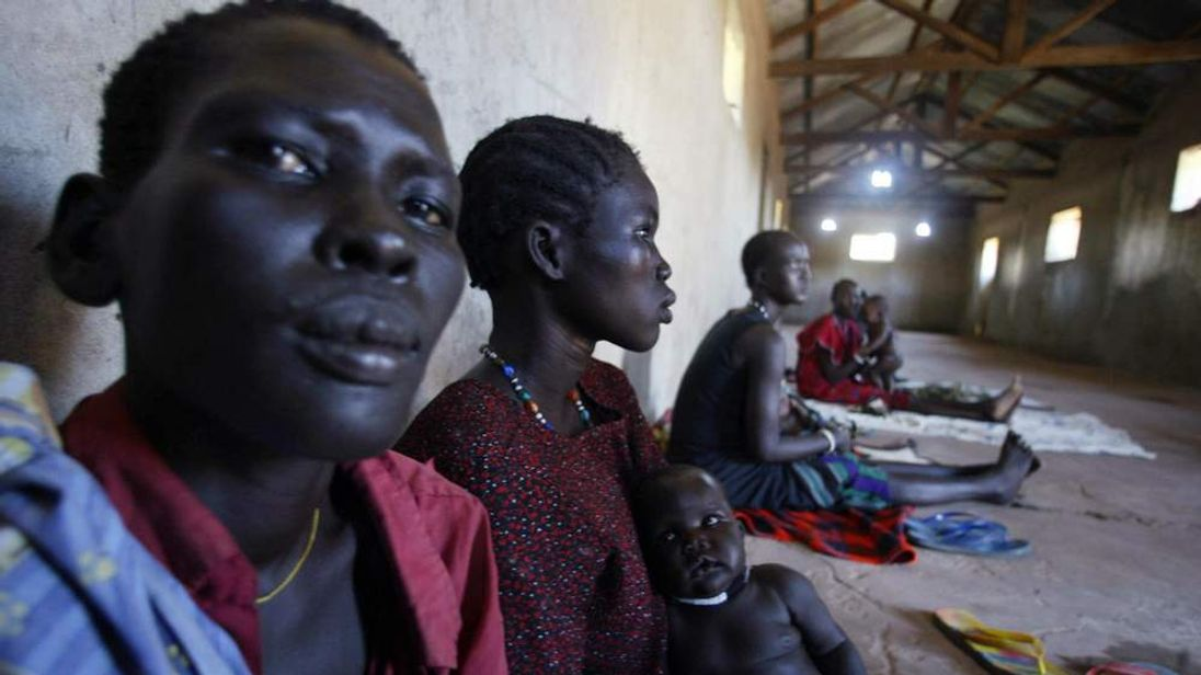 Sudanese women prisoners wait in Rumbek's central prison