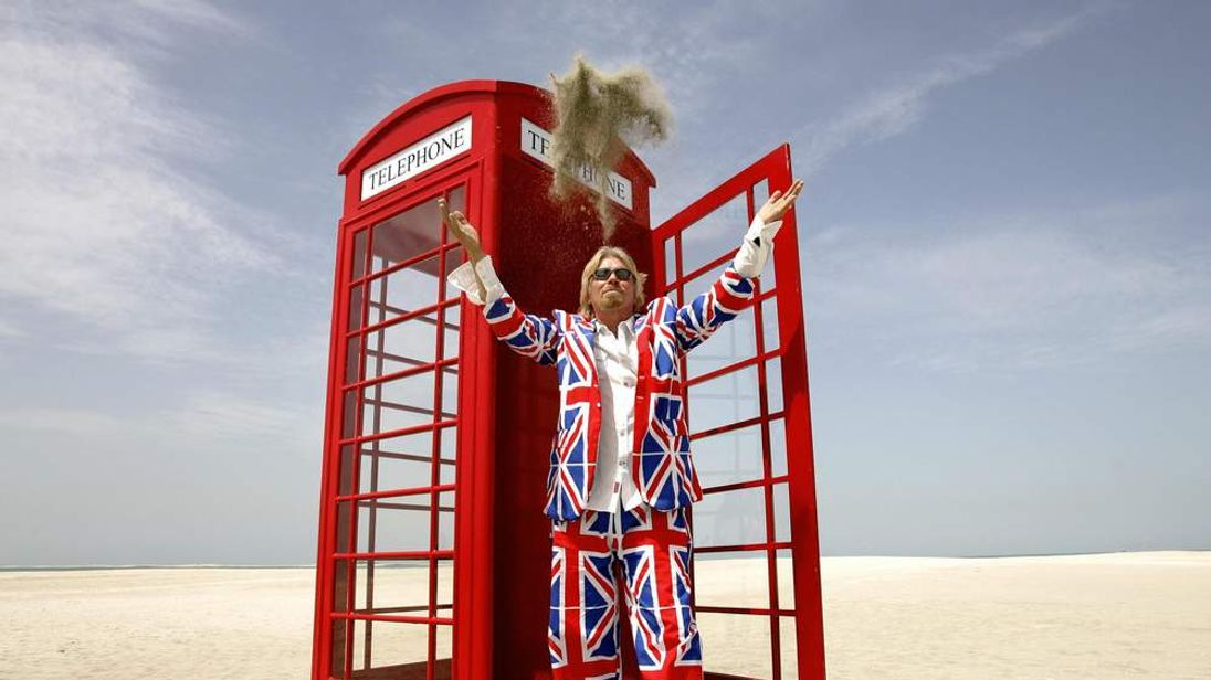 British entrepreneur Sir Richard Branson wears a suit covered in Union flags