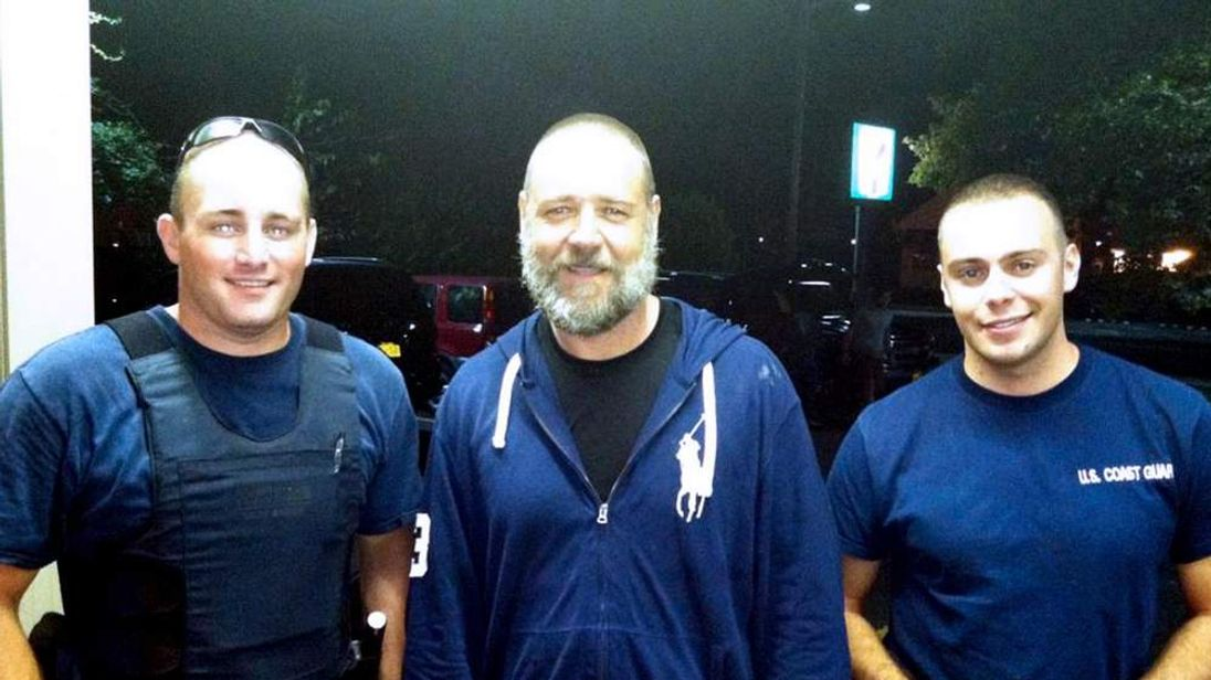 Russell Crowe (centre) with Coast Guard petty officers