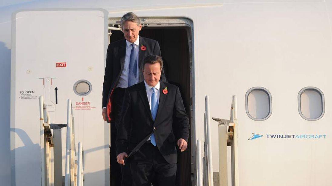 David Cameron and Philip Hammond arriving in Dubai