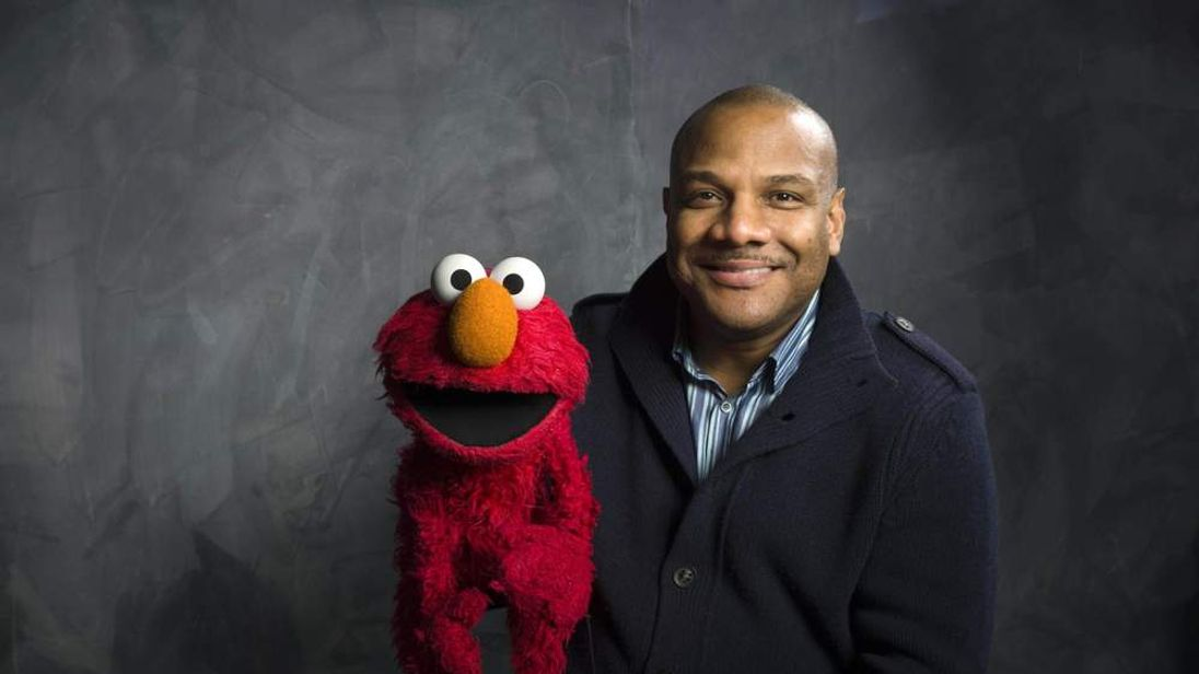 """Sesame Street"" muppet Elmo and puppeteer Kevin Flash poses for a portrait in the Fender Music Lodge during the 2011 Sundance Film Festival to promote the film ""Being Elmo"""