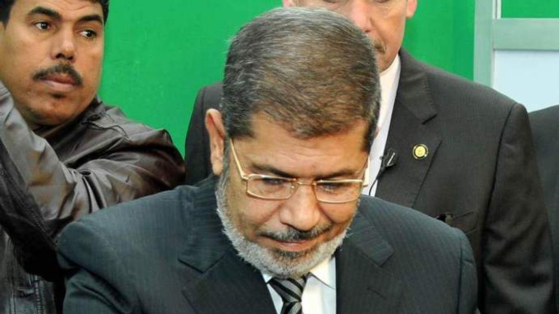 President Mohammed Morsi casts his vote in the Egyptian referendum