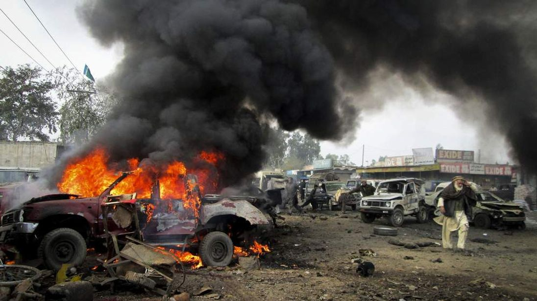 A vehicle burns after a bomb blast in Pakistan