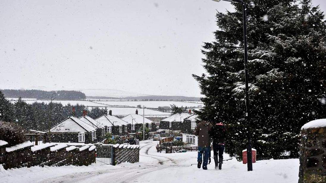 General view of a street in Pricetown, Dartmoor, as snow starts to fall again.