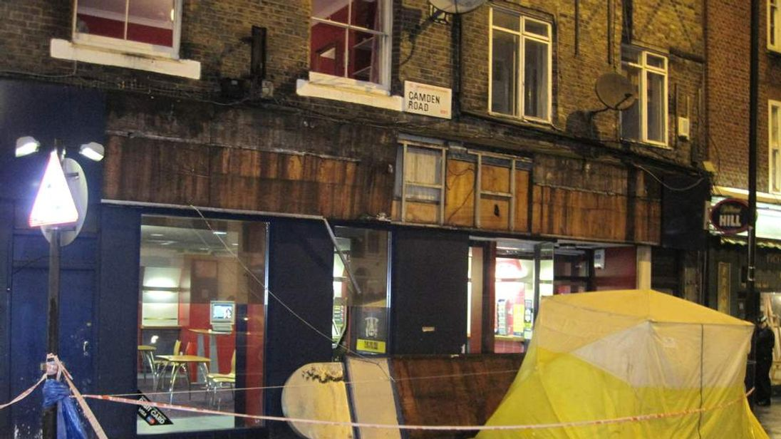 Man killed by shop sign