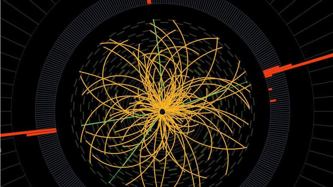 This 2011 image provided by CERN, shows a real CMS proton-proton collision in which four high energy electrons (green lines and red towers) are observed