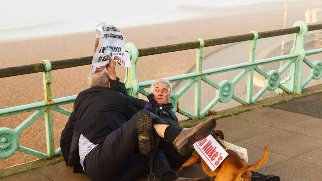Iain Dale fighting with a protester