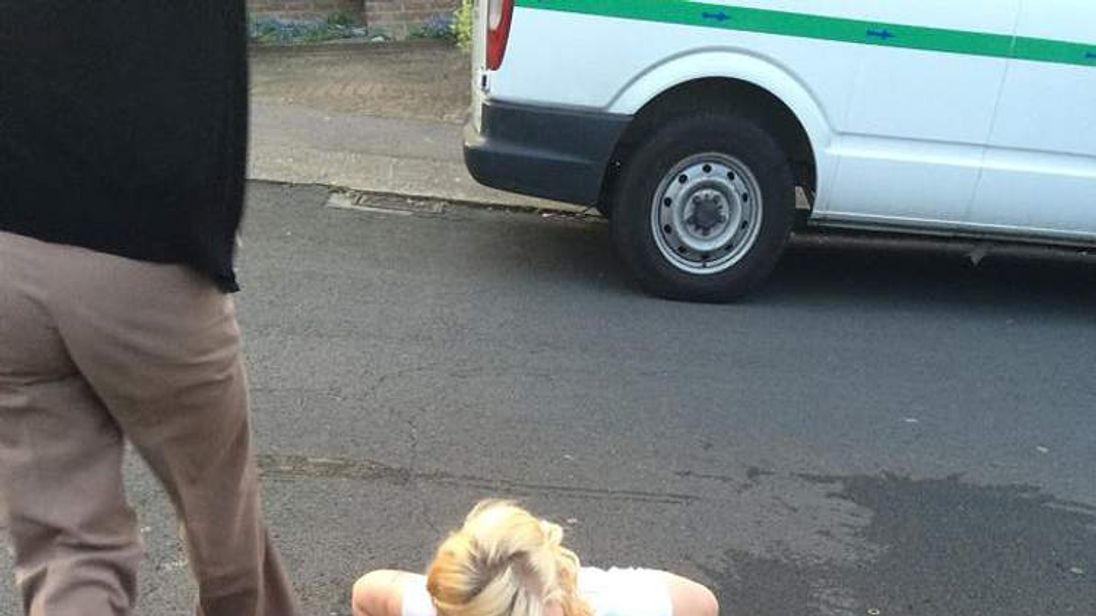 Ella Birchenough being rescued by firefighters after getting stuck in a storm drain