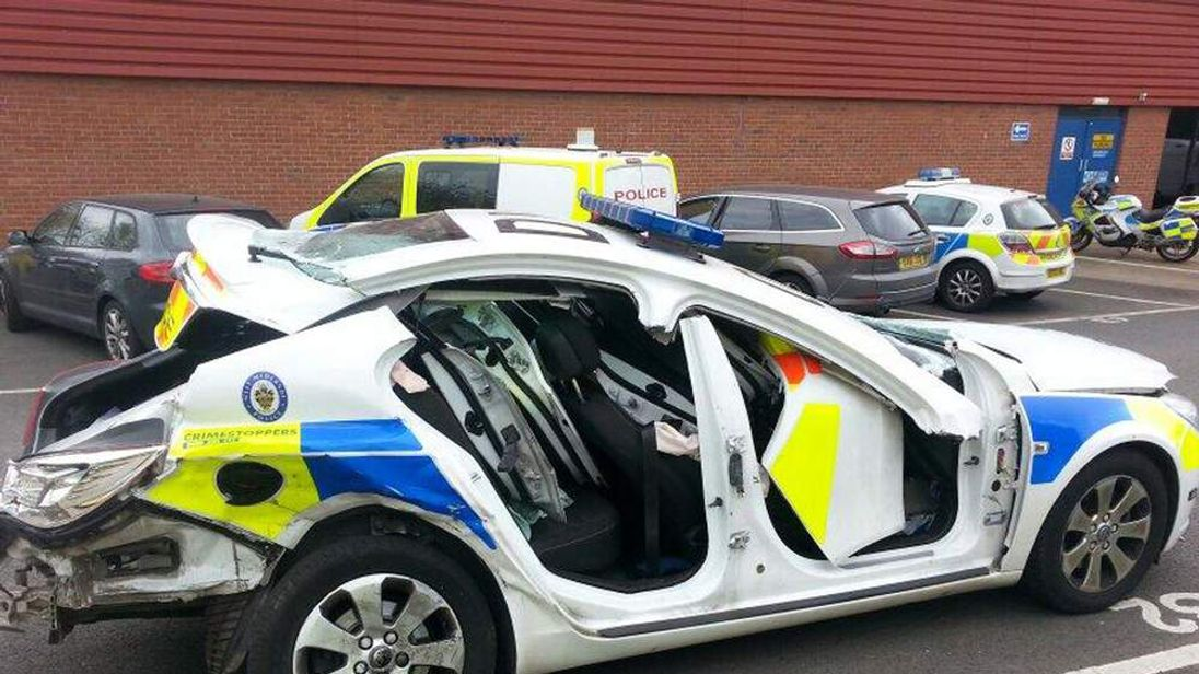 Driver held after police car crash