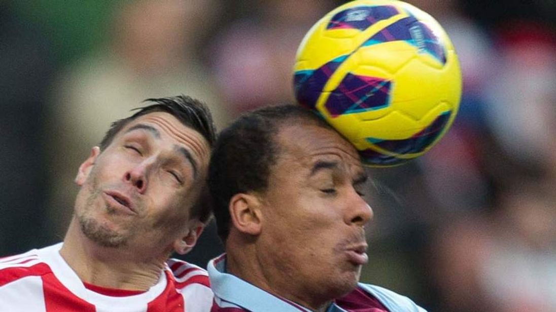 Gabriel Agbonlahor and Geoff Cameron contest a header
