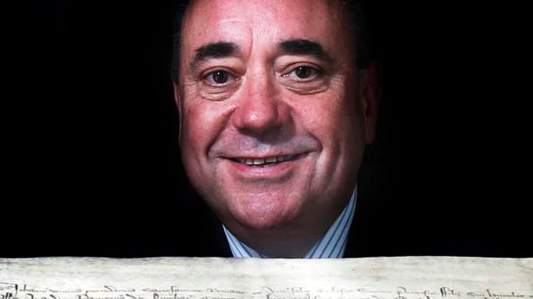 Alex Salmond  with a copy of the declaration of Arbroath during a visit to Arbroath Abbey, the birthplace of the Declaration of Arbroat