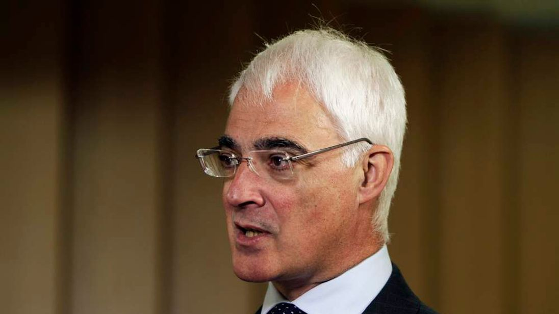 Alistair Darling, head of the Better Together anti-secessionist campaign and former British finance minister, answer questions during an interview with Reuters in London 2014
