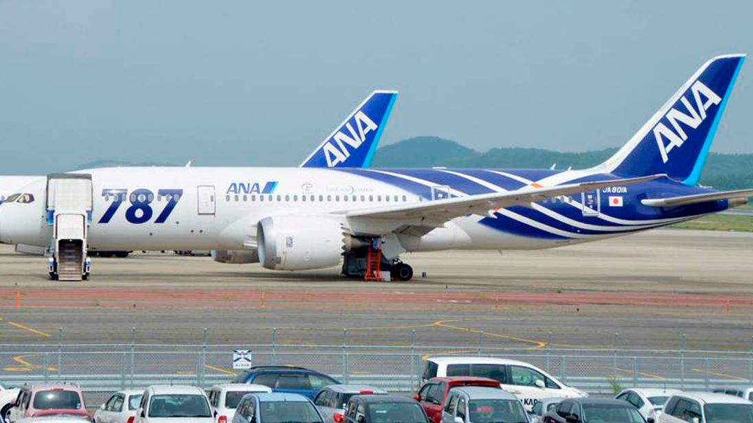 An ANA 787 Dreamliner aircraft, from which white smoke spewed at the left engine, parked at the Okayama airport