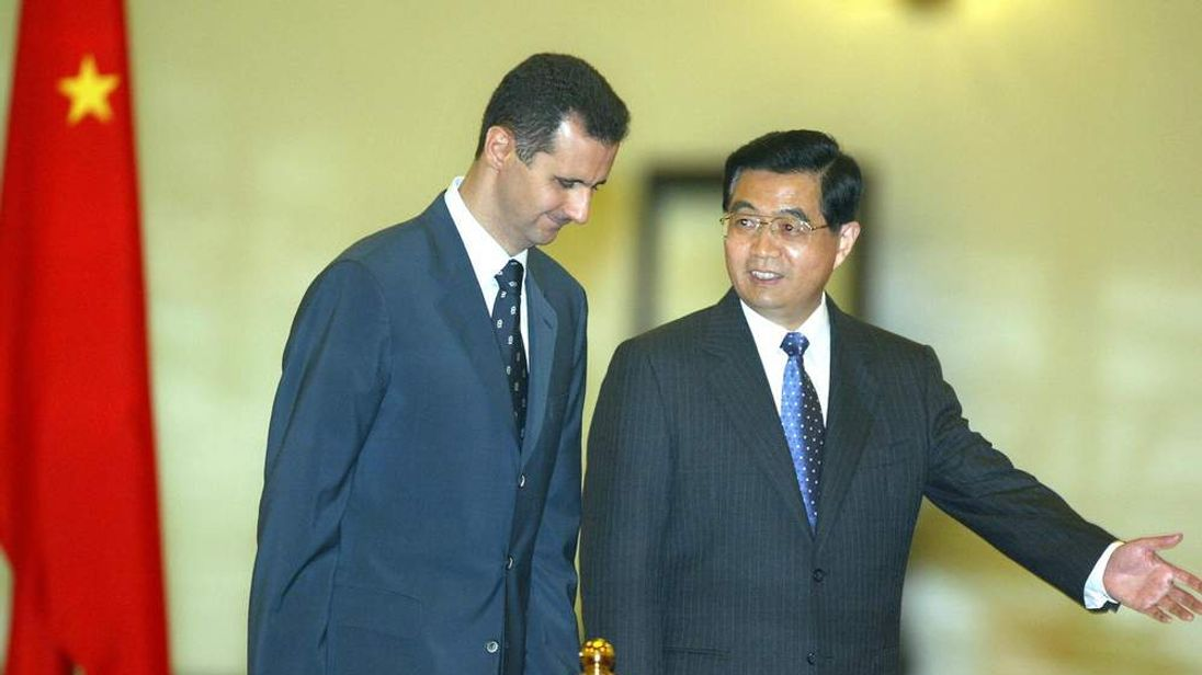 Assad (L) and Jintao in 2004