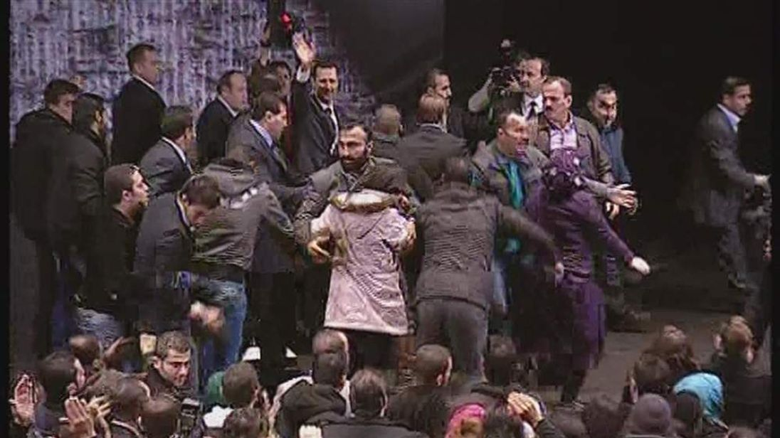 Bashar al Assad is mobbed by supporters.