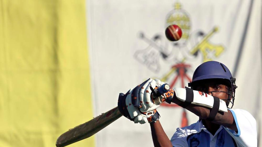 A player takes part in a Vatican cricket league training session
