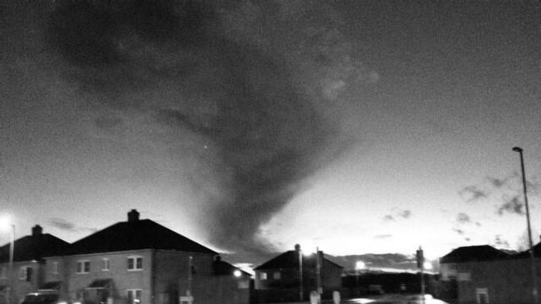 Twitter user Grant Kavanagh took this picture of a mini tornado in Knaphill Surrey.