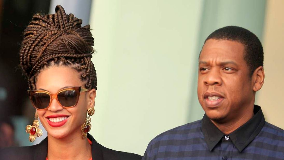 Beyonce and her husband rapper Jay-Z walk as they leave their Hotel in Havana