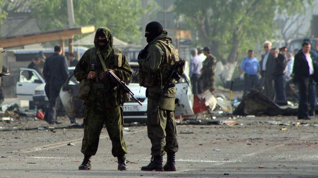 Special forces officers guard the site of two blasts in the Dagestan's capital Makhachkala