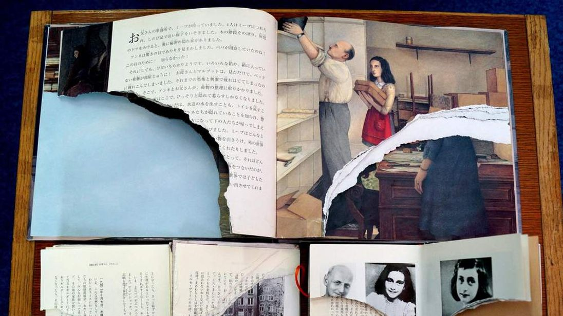"Ripped pages of three books of Anne Frank's ""Diary of Young Girl"""