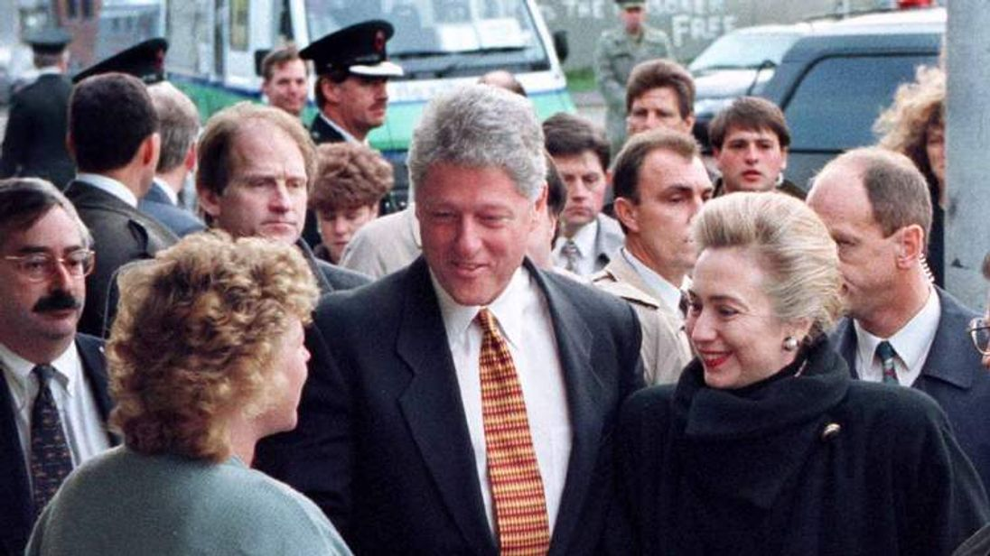 US President Bill Clinton and his wife Hillary meet a woman outside a Belfast market