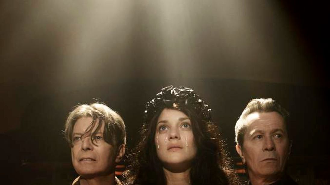 (left to right) David Bowie, Marion Cotillard and Gary Oldman