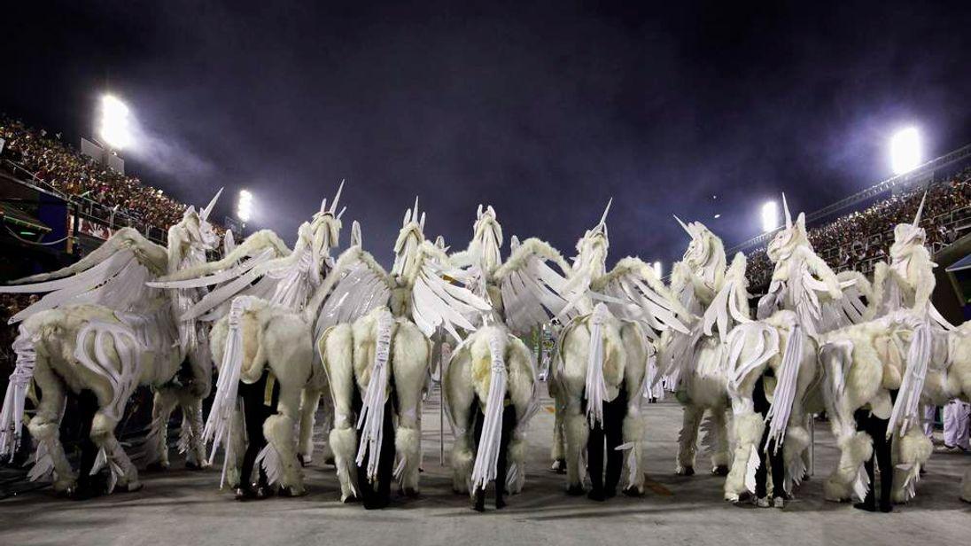 Revellers in unicorn costumes from the Grande Rio samba school participate in the second night of the annual Carnival parade in Rio de Janeiro's Sambadrome