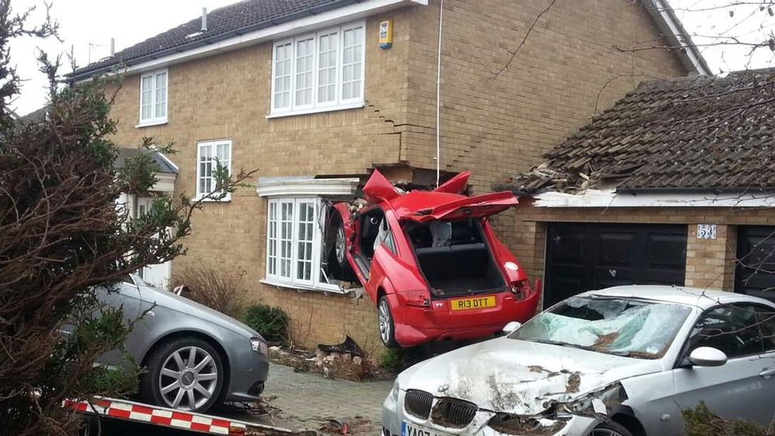 A car wedged into a house after a crash