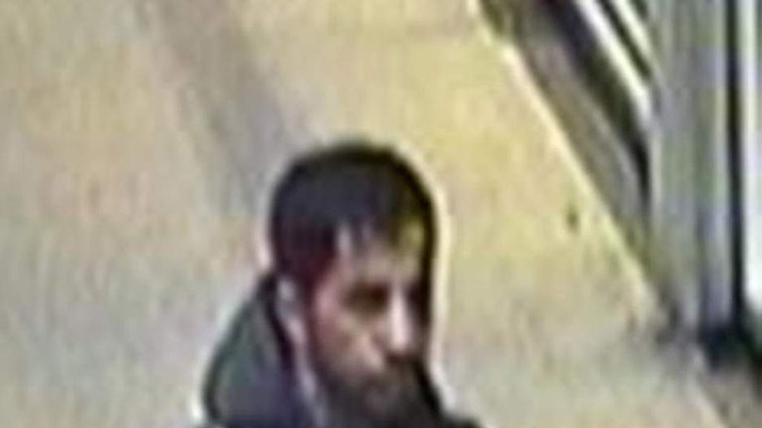 CCTV still of a man police want to trace after a bottle of hydrochloric acid was left on a train