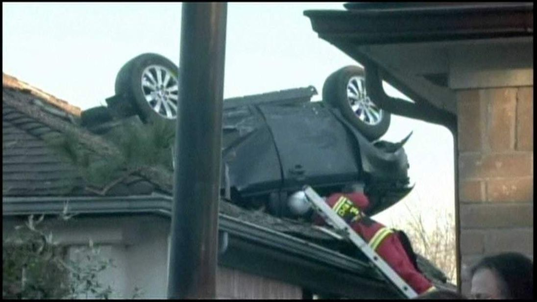 Car Lands On House Roof