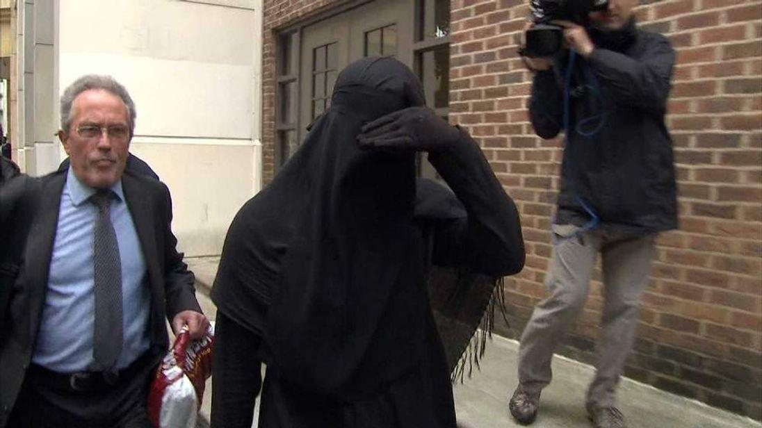 veil case woman leaving court