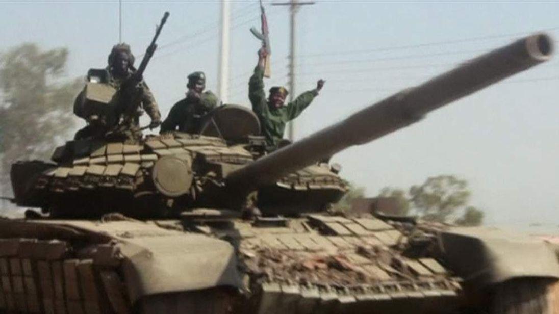 Tank Patrols Street In South Sudan